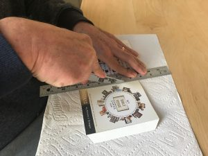 Place the box on two layers of paper towels. Using a dull butter knife and a ruler carefully score the dotted lines before attempting to fold them.