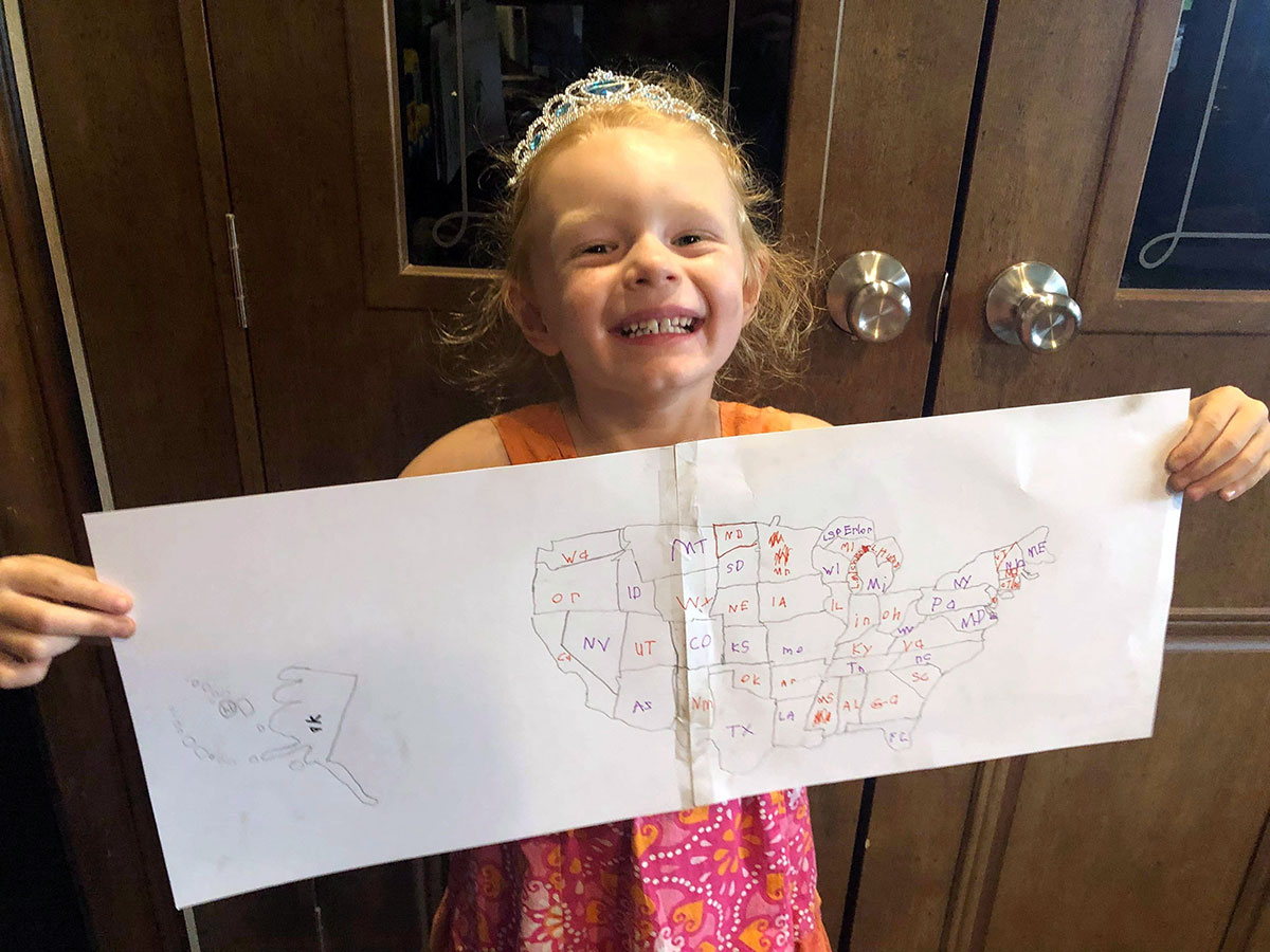 Julia, 5 years old, from Illinois, shows the USA Map she drew using ARTK12's Draw the USA